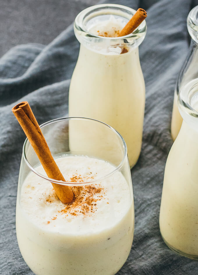 Easy and best low carb traditional eggnog drink with almond milk served in milk jugs and glasses