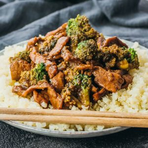 beef and broccoli served with riced cauliflower