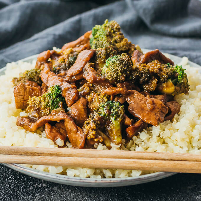 Low carb, keto friendly beef and broccoli recipe in a closeup view with chopsticks