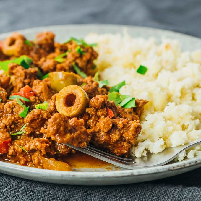 Close up view of an easy Mexican picadillo stew with olives and rice