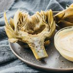Artichokes cooked in the Instant Pot and served with a spicy garlic mustard dip