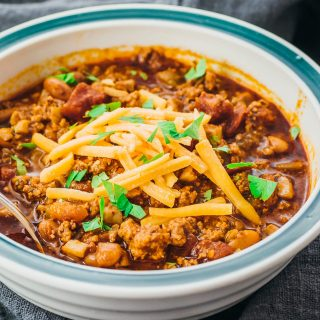 Low carb ground beef chili with beans served in a bowl and made in the instant pot pressure cooker