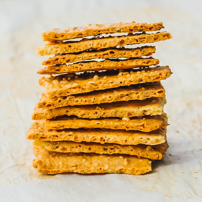 tall stack of gluten free low carb crackers made with parmesan cheese and almond flour