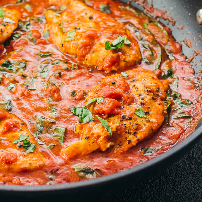 close up view of chicken in tomato sauce