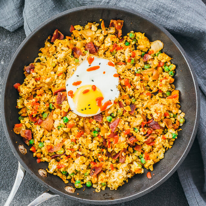 Overhead view of cauliflower fried rice dinner with frozen vegetables like peas and carrots