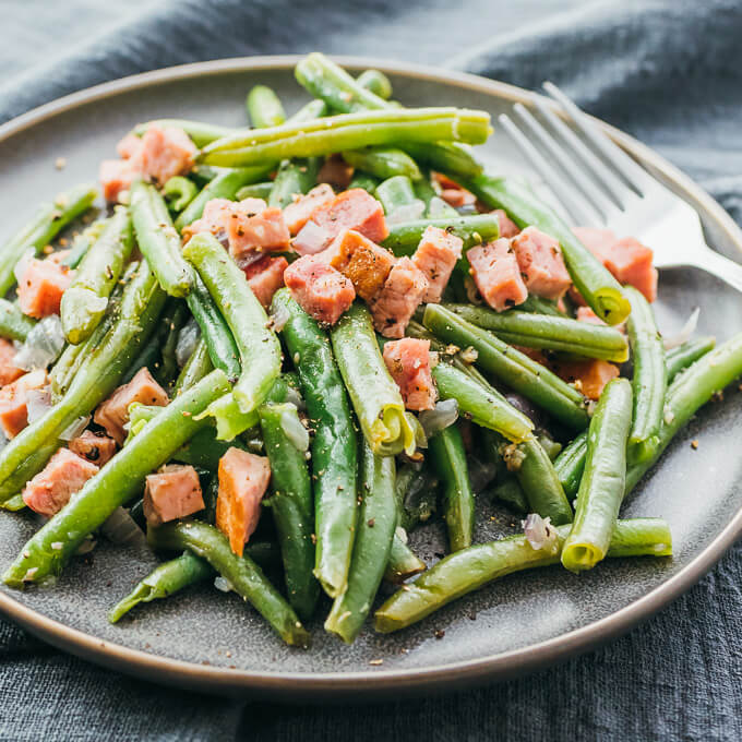 Instant Pot green beans and ham served on a gray plate