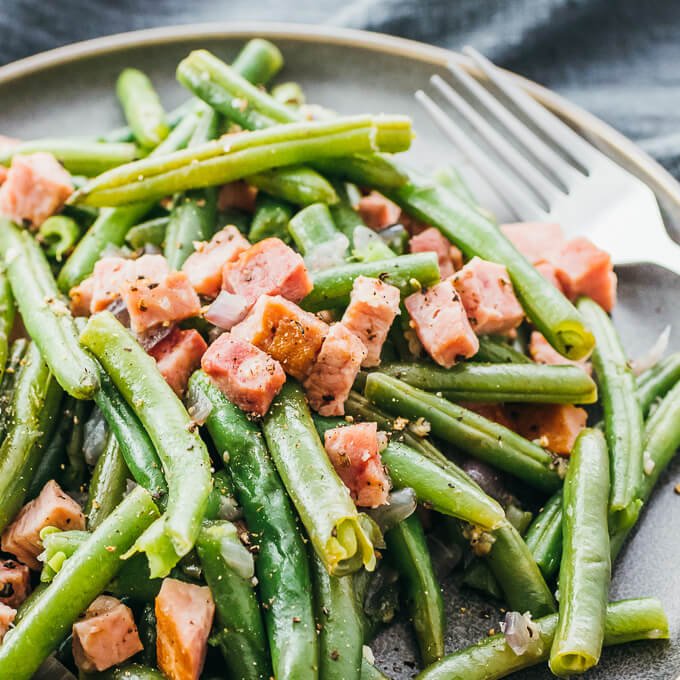 Closeup view of tender southern style green beans and ham cooked in the instant pot