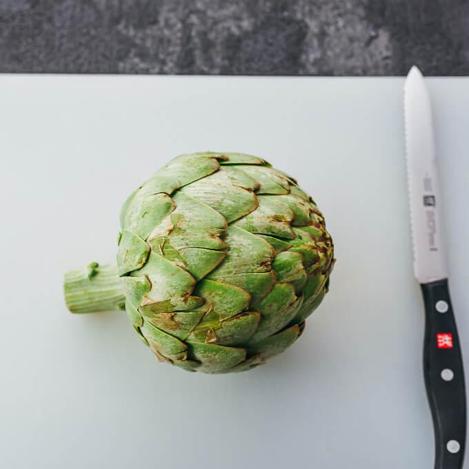 artichoke on cutting board