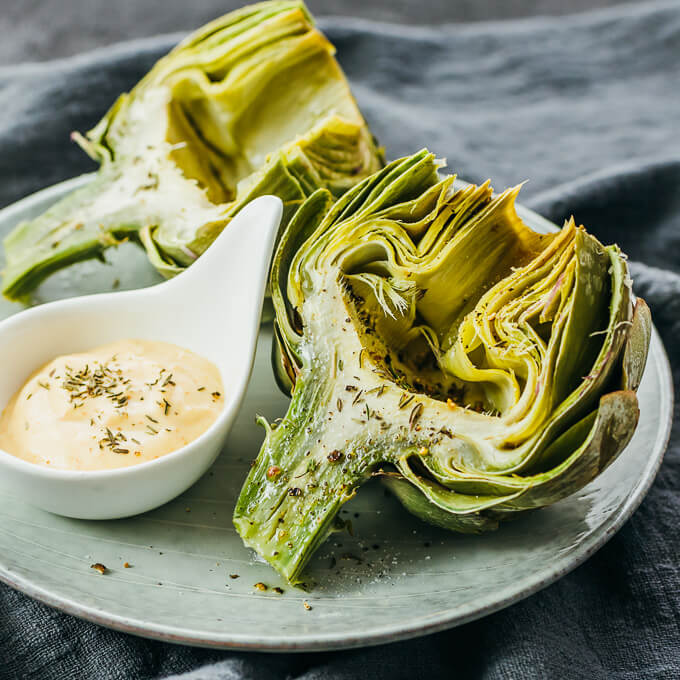 Microwaved artichokes served with spicy garlic mustard mayo dipping sauce