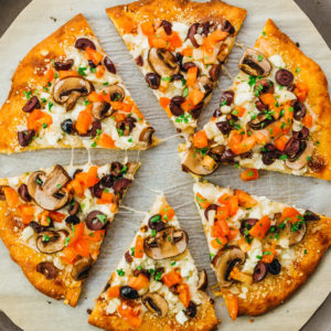 overhead view of sliced keto pizza with toppings
