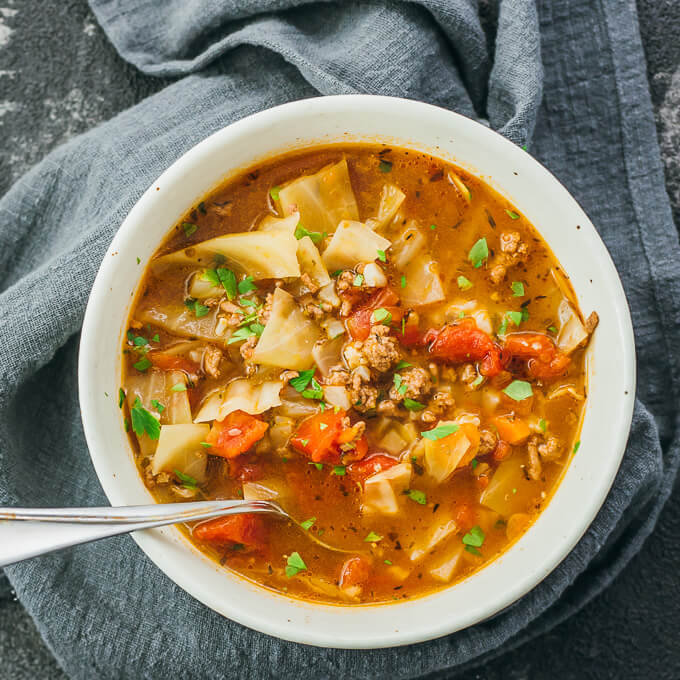 Unstuffed cabbage roll soup recipe with ground beef served in white bowl