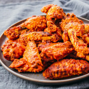 chicken wings tossed with sauce