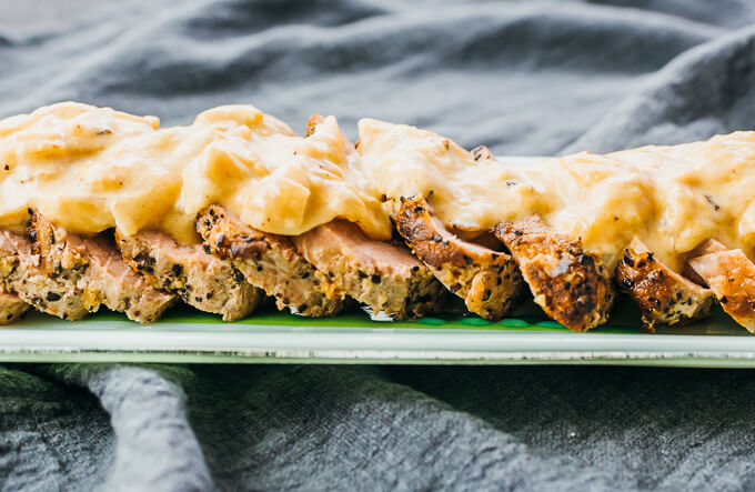 instant pot pork tenderloin sliced and topped with easy mustard gravy sauce