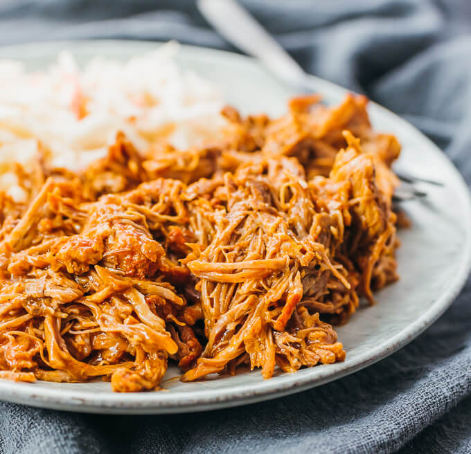 instant pot pulled pork with bbq sauce served on plate