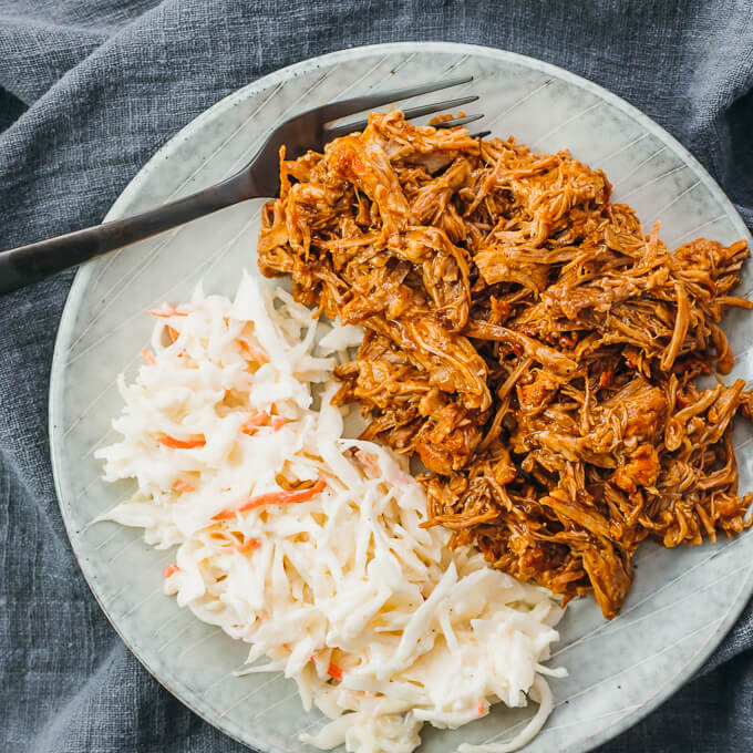instant pot pork carnitas served with coleslaw and bbq sauce