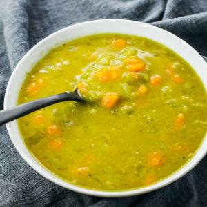 split pea soup served in white bowl