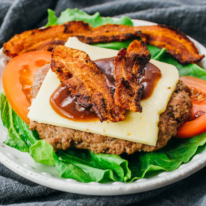 instant pot burger plate with bacon, lettuce, tomatoes, cheese, bbq sauce