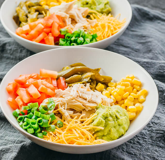 instant pot shredded chicken burrito bowl with peppers tomatoes cheese corn guacamole