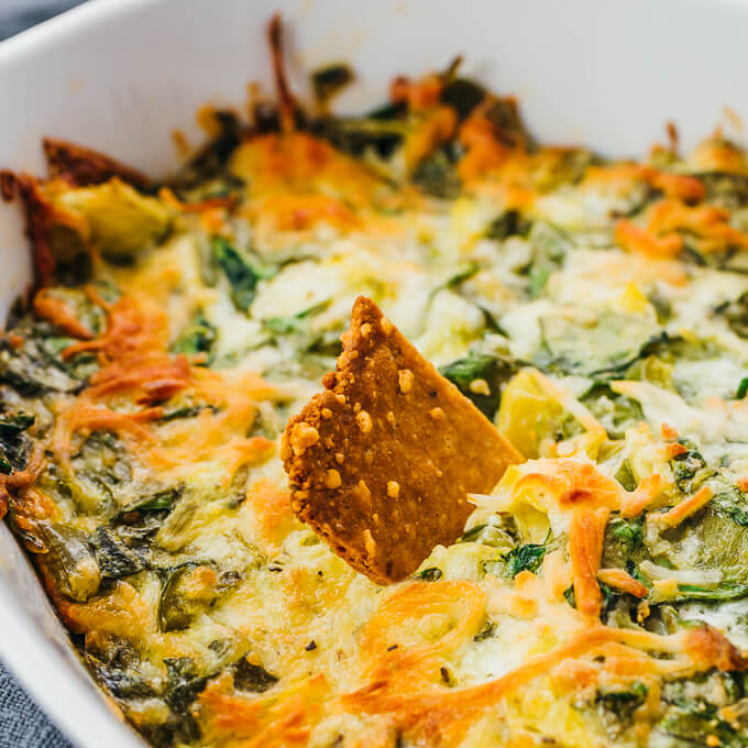 spinach artichoke dip with keto and low carb crackers with almond flour
