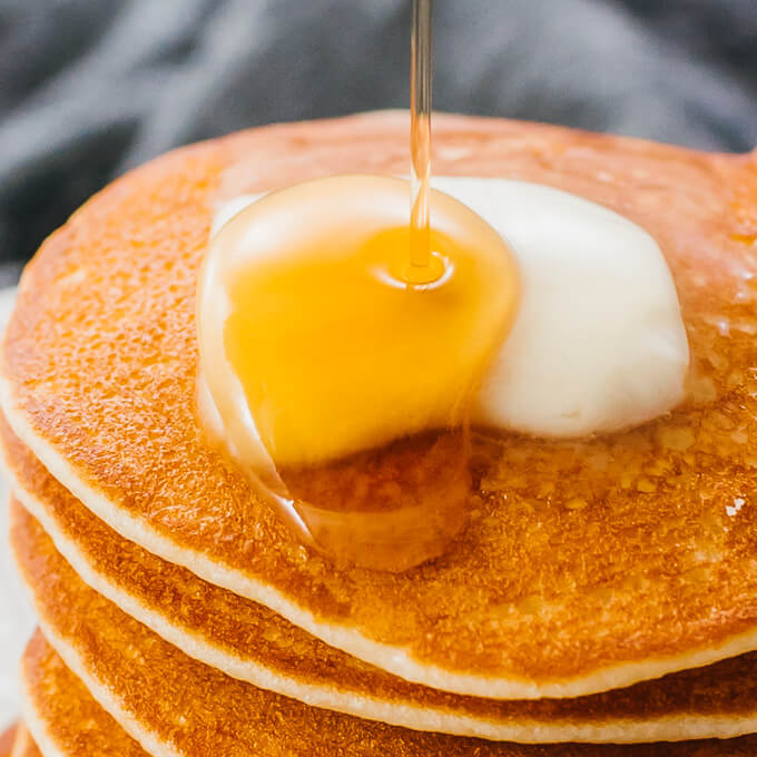 drizzling syrup over low carb silver dollar pancakes