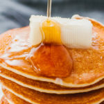 pancakes drizzled with syrup