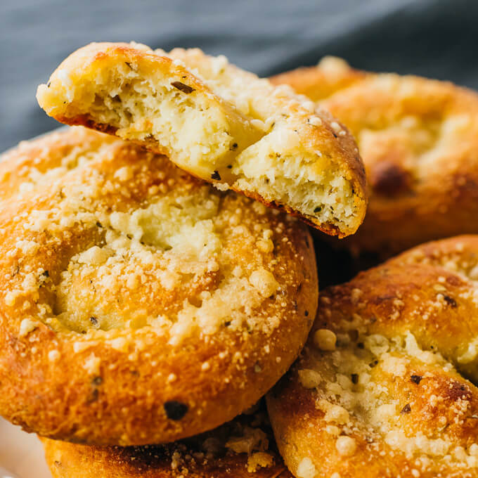 taking a bite out of cheesy garlic bread knots