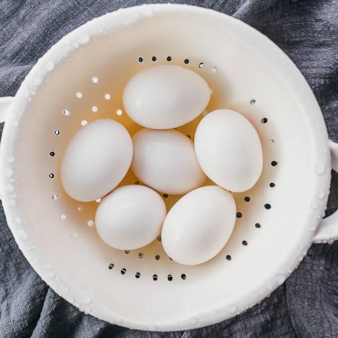 hard boiled eggs cooling in colander