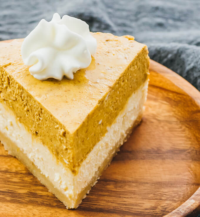 slice of keto instant pot pumpkin cheesecake on a wooden plate
