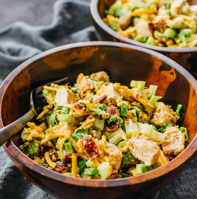 keto chicken salad loaded with bacon and avocado served in wooden bowls