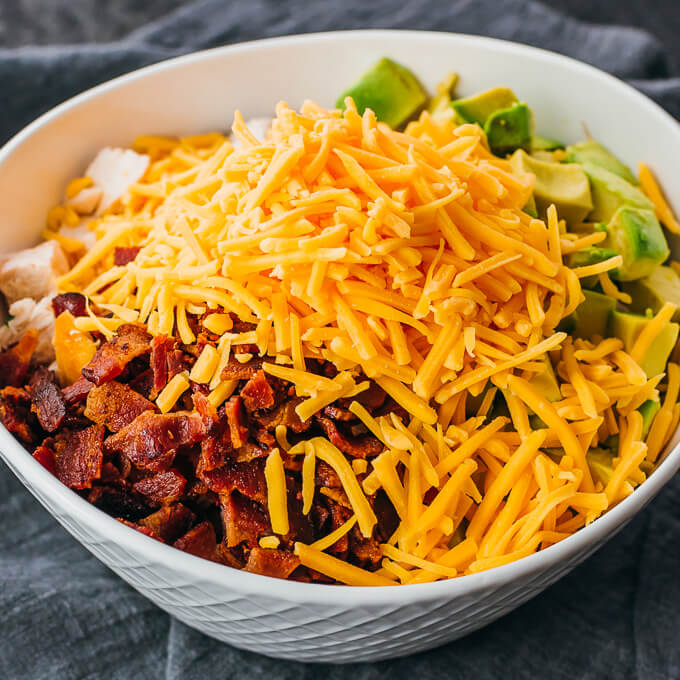 an easy homemade chicken salad topped with shredded cheddar cheese