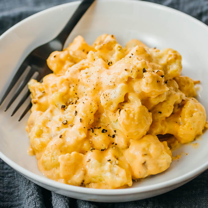 cauliflower mac and cheese served in white bowl