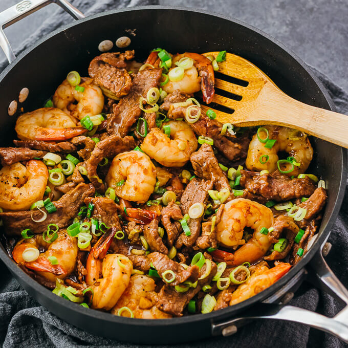 asian surf and turf stir fry cooked in a black pan