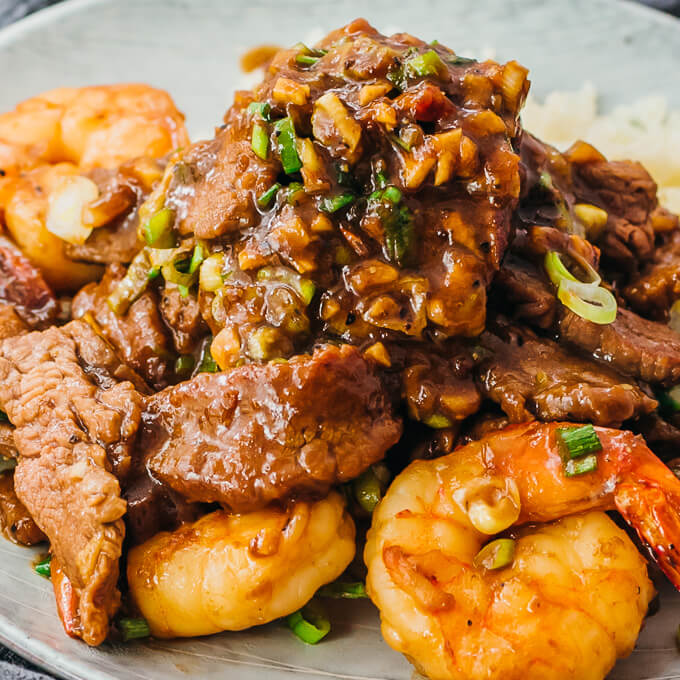 chinese surf and turf served with a healthy sauce on a plate