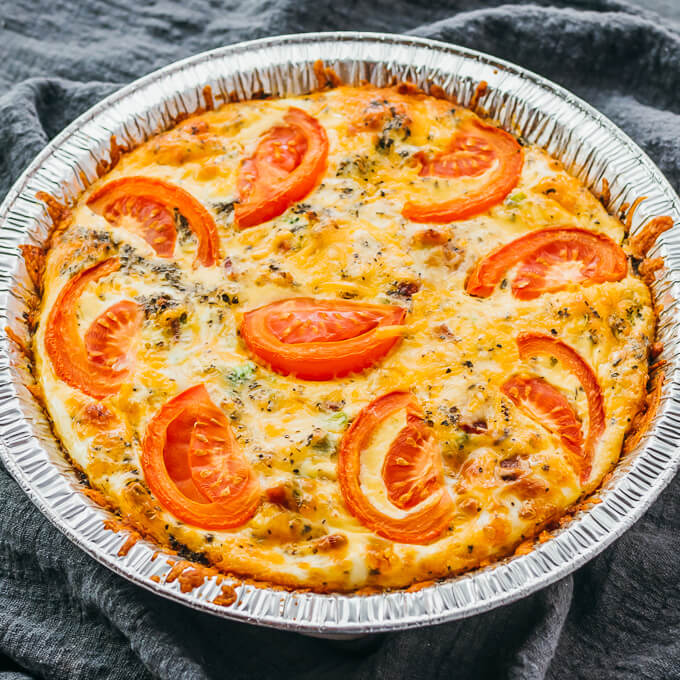 crustless quiche with broccoli and cheddar cheese in a foil pie dish