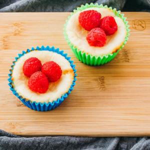 mini cheesecake bites topped with raspberries