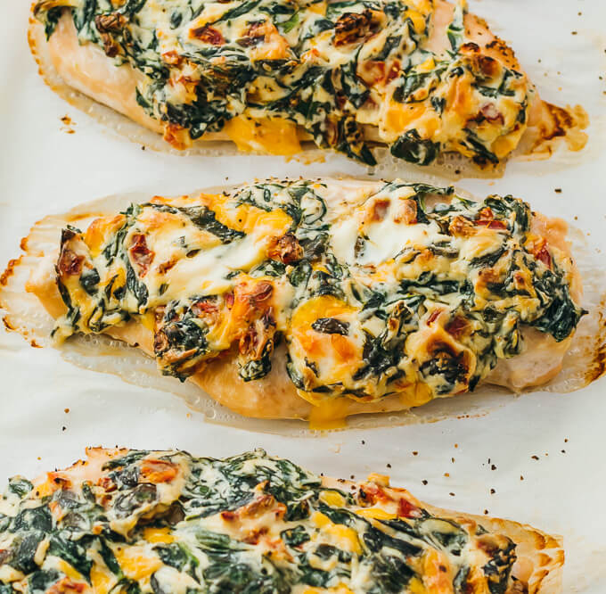healthy keto oven baked chicken breasts on parchment paper