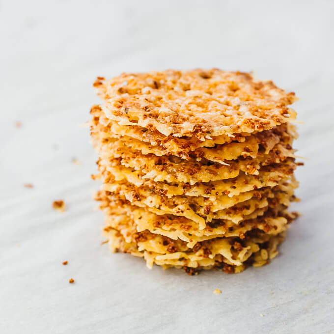 tall stack of thin keto chips made with parmesan cheese