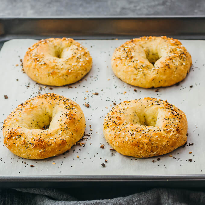 homemade fathead bagels on parchment paper after baking
