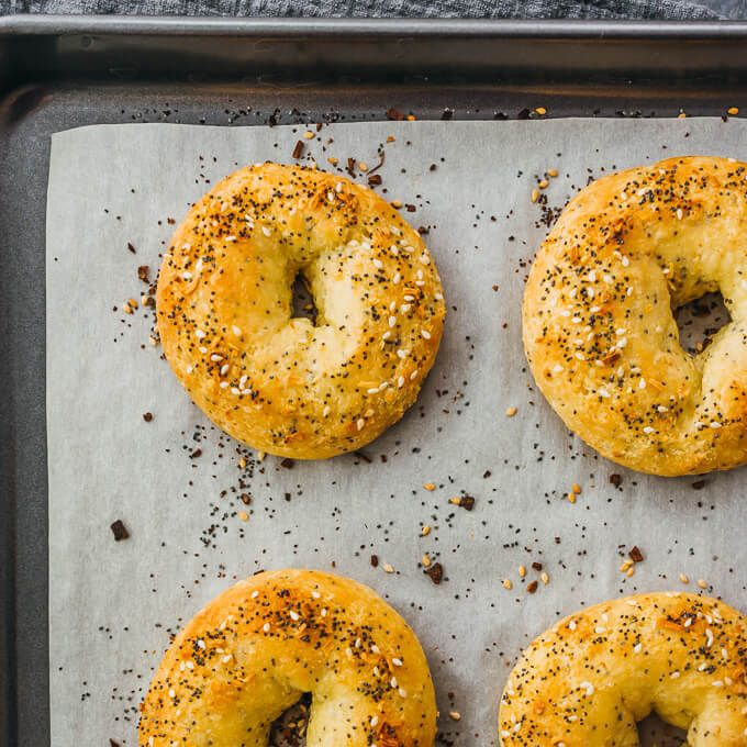 overhead view of gluten free bagels sprinkled with everything bagel seasoning