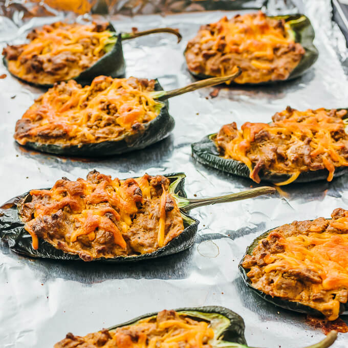 low carb stuffed poblano peppers on foil lined baking sheet