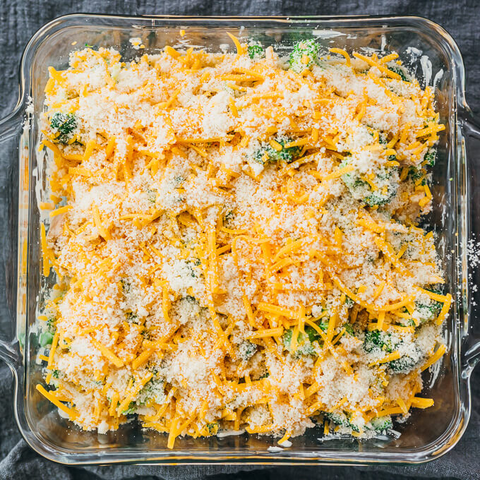 topping baking dish with cheeses