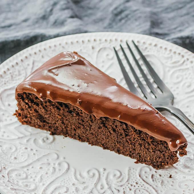chocolate cake slice with black fork