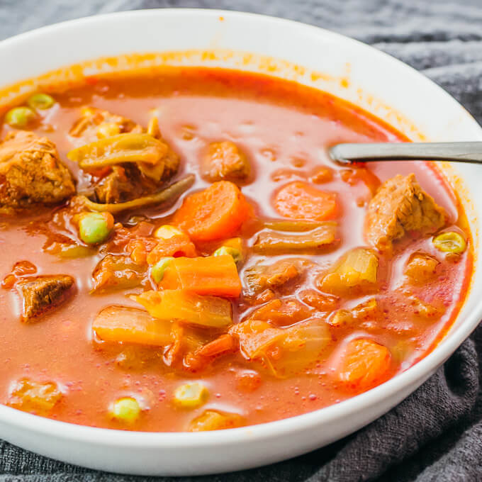 vegetable beef soup served in white bowl