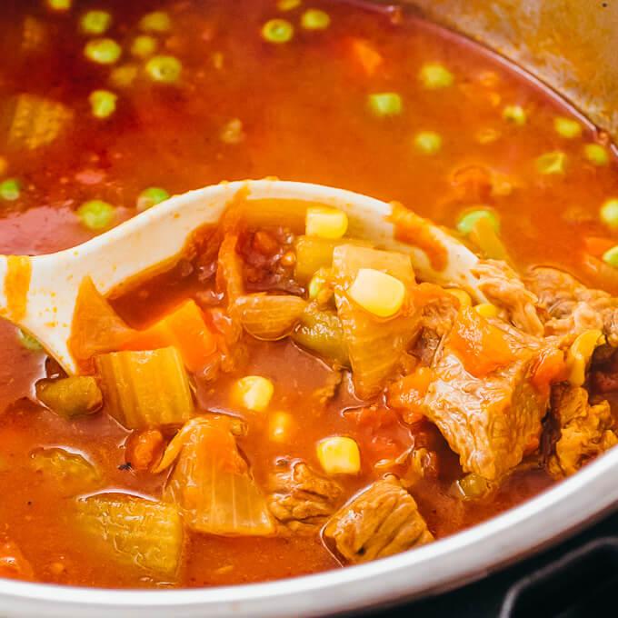 ladling vegetable beef soup