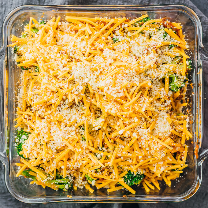 topping casserole with cheddar and parmesan cheese