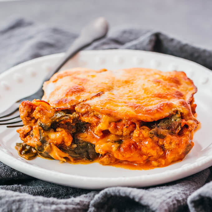 close up view of sliced keto lasagna with meat layers