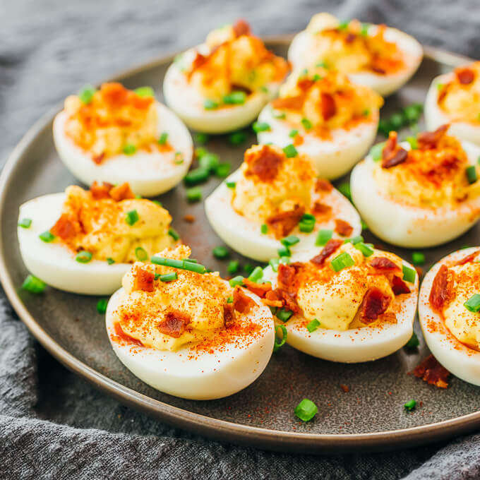 deviled eggs on gray platter