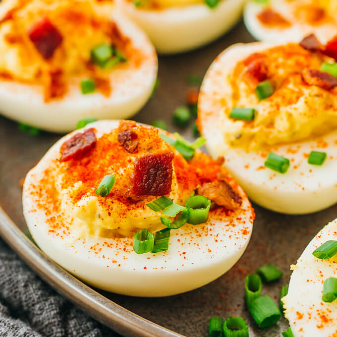 up close view of a keto deviled egg topped with chives