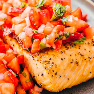 pan seared salmon fillet topped with strawberry relish