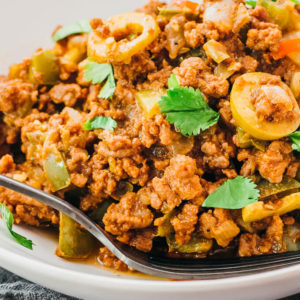 ground beef picadillo in white bowl